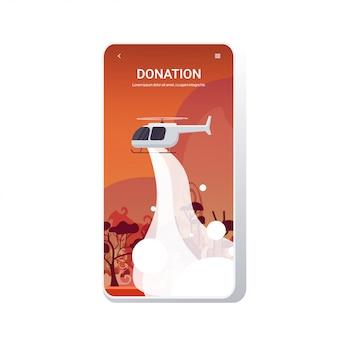 Helikopter dooft gevaarlijke bosbrand in australië brandend bosbrand droog hout brandende bomen brandbestrijding natuurramp donatie concept intense oranje vlammen telefoonscherm mobiele app