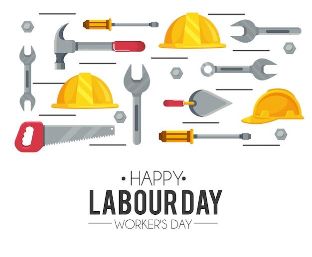 Helmmateriaal met hamer en zaag aan arbeidsdag