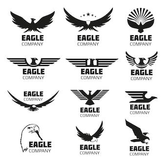 Heraldische symbolen met adelaarsilhouetten Premium Vector