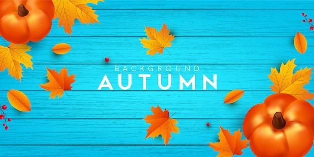 Herfst achtergrond hout met bladeren en pompoen.
