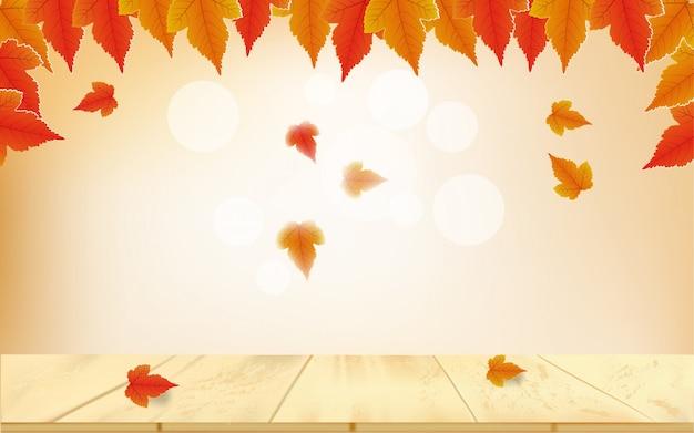 Herfst bokeh achtergrond met gevallen bladeren op tafel