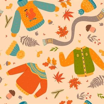 Herfst naadloos patroon met kleding en bladeren. vectorafbeeldingen.