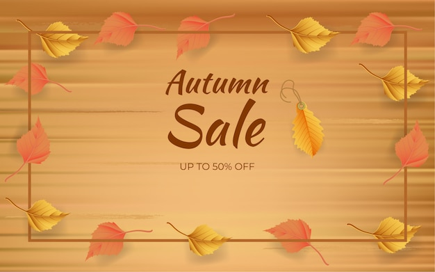 Herfst verkoop ontwerpconcept met bladeren op een houten bord