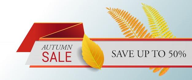 Herfstverkoop, bespaar tot vijftig procent belettering, gele bladeren.