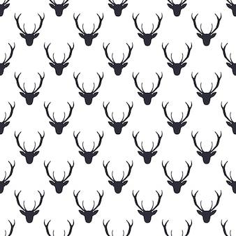 Herten hoofd patroon. wild dier symbolen naadloze achtergrond. silhouet zwart-wit ontwerp