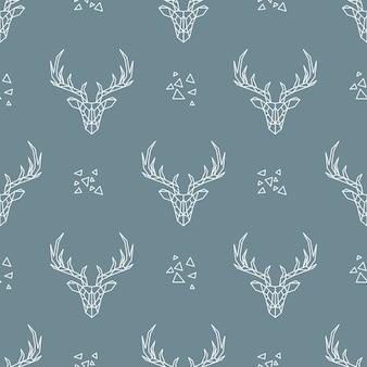 Herten naadloze patroon op donkerblauwe achtergrond.