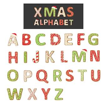 Het alfabet van het kerstmiskoekje op wit wordt geïsoleerd dat