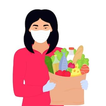 Het aziatische vrijwilligersmeisje houdt een pakket met voedsel. veilige bezorgservice.