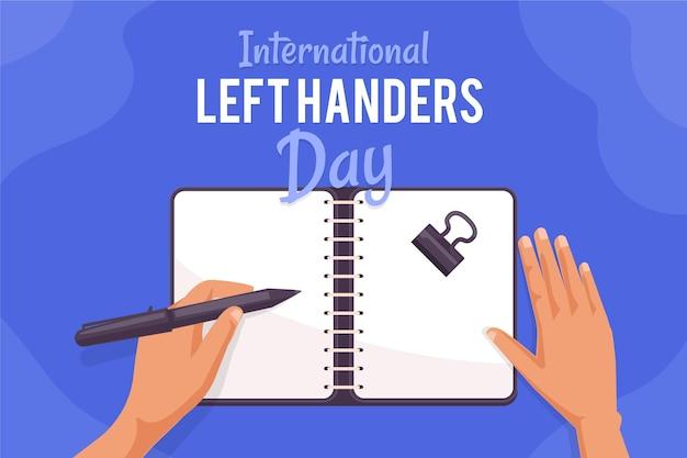 Het concept van de linkshandige dag met hand het schrijven