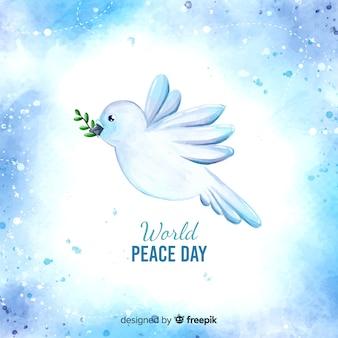 Het concept van de vredesdag met waterverfduif