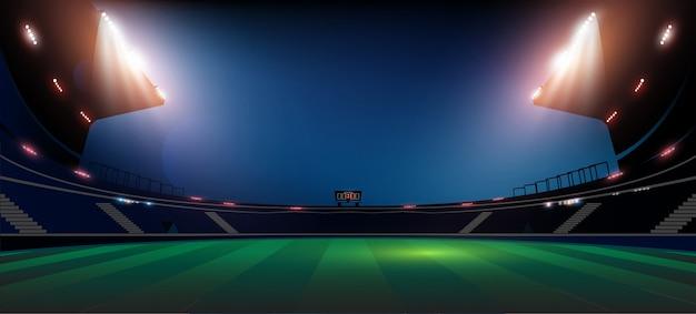 Het gebied van de voetbalarena met de heldere verlichting van stadionlichten