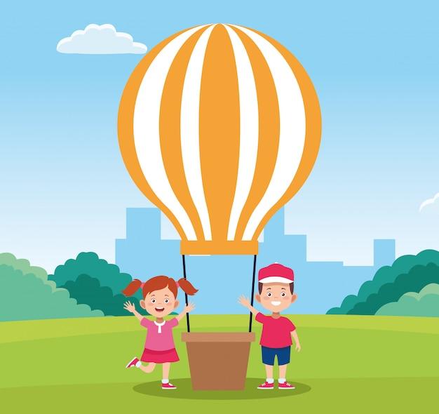 Het gelukkige ontwerp van de kinderendag met gelukkig jongen en meisje naast hete luchtballon