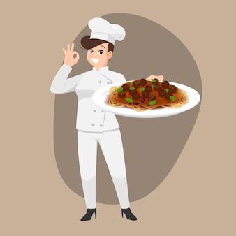Het gelukkige portret van het chef-kokbeeldverhaal van jonge vrouwenkok die hoed draagt en de spaghettischotel van de chef-kok eenvormige greep