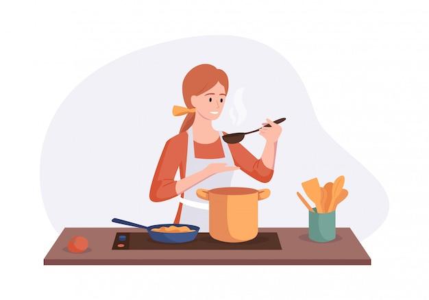 Het glimlachen van chef-kok het koken op keukenlijst. vrouw kookte soep en proeft het met een lepel. illustratie huis concept zelfgemaakte maaltijden bereiden voor het diner