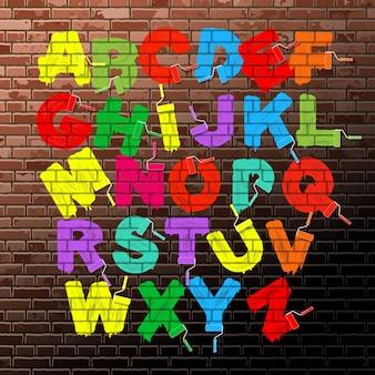 Het heldere fluorescerende alfabet van de kleurenrolborstel op de oude bakstenen muurachtergrond