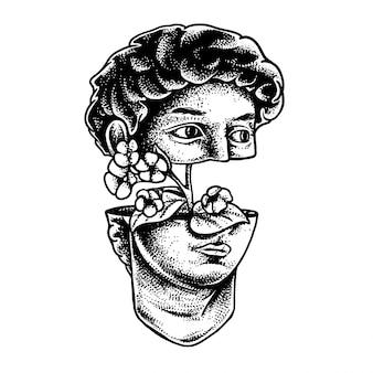 Het hoofd van een antiek beeld en flowe