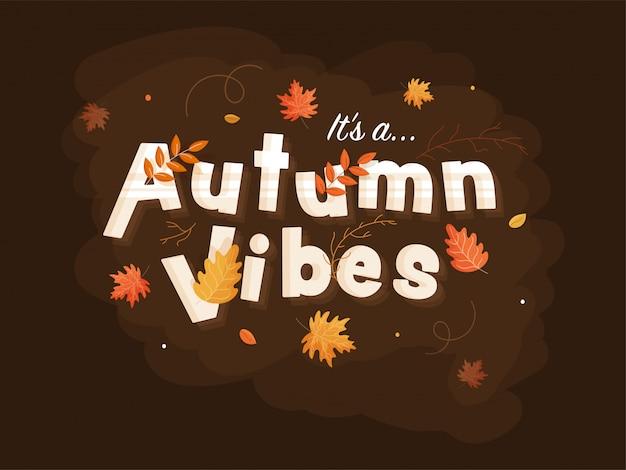 Het is een herfst vibes tekst versierd met bladeren op bruine achtergrond.