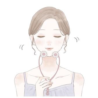 Het is een vrouw die het gezicht masseert met een mooie gezichtsroller.