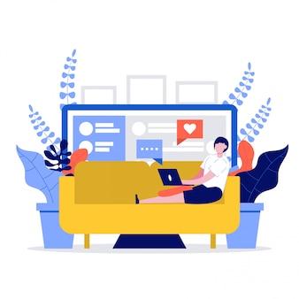 Het jonge vrouw ontspannen bij bank met laptop. het meisje chatten met vrienden via sociale media.