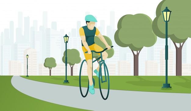 Het karakter van de jonge mens berijdt sportfiets op parkweg