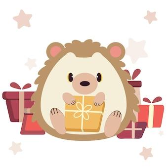 Het karakter van een schattige egel met een geschenkdoos