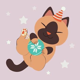 Het karakter van een schattige kat draagt een feestmuts die met een kerstbal speelt