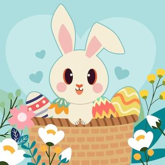 Het karakter van schattige konijnenzitting in de mand met een paasei in de bloementuin