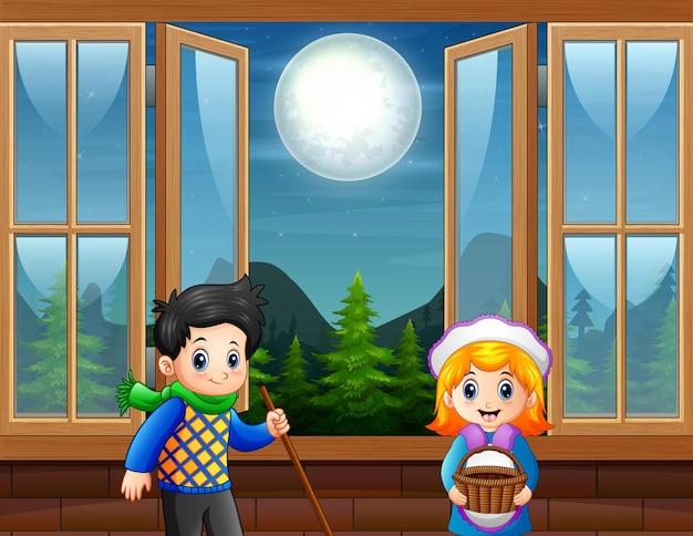 Het kind staat bij het open raam
