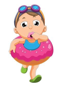 Het kleine meisje gebruikt de donutzwemband ter illustratie of illustratie