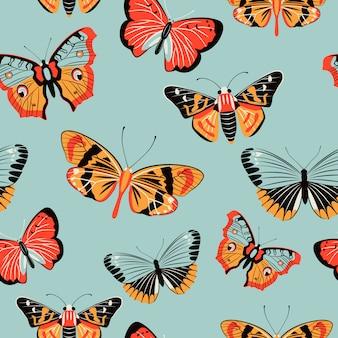 Het kleurrijke naadloze patroon van de vlindermot