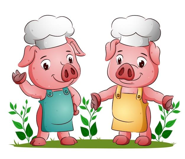 Het koppel van het varken gebruikt het kleurrijke schort met de koksmuts ter illustratie
