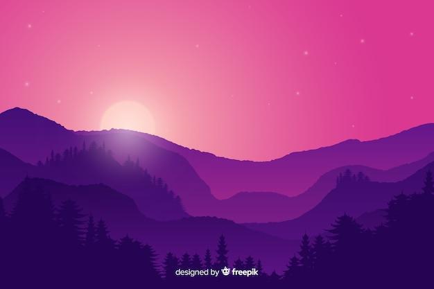 Het landschap van zonsondergangbergen met purpere gradiëntkleuren