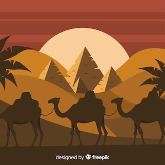 Het landschapsachtergrond van egypte met kamelen en piramids