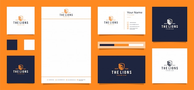 Het leeuwlogo met een gratis visitekaartje en briefhoofd