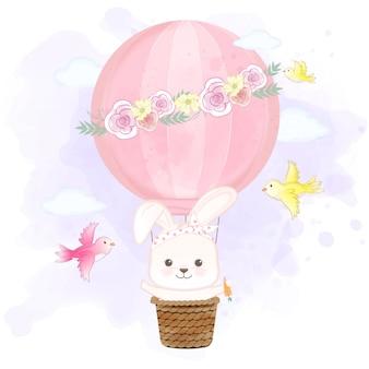 Het leuke konijn die op hete luchtballon drijven en vogels overhandigt getrokken beeldverhaalillustratie