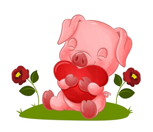 Het lieve varkentje knuffelt het grote gekleurde hart van de illustratie
