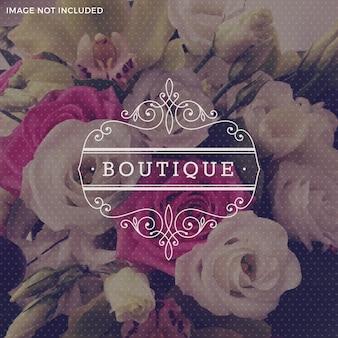 Het malplaatje van het boutiqueembleem met bloeit kalligrafisch elegant ornamentkader - illustratie