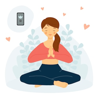 Het meisje beoefent yoga met telefoon meditatieconcept yoga mobiele app meisje in lotushouding