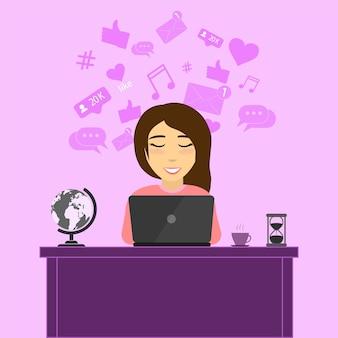 Het meisje communiceert met vrienden in een chat via een sociaal netwerk. het meisje achter de laptop -