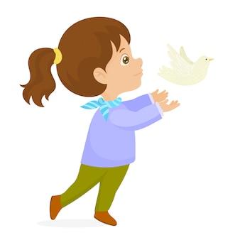 Het meisje geeft een witte vredesduif vrij