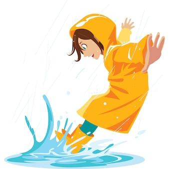 Het meisje houdt van in regenplassen te stampen in het regenachtige seizoen.
