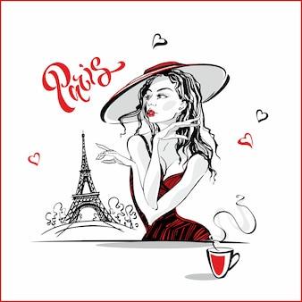 Het meisje in de hoed die koffie drinkt