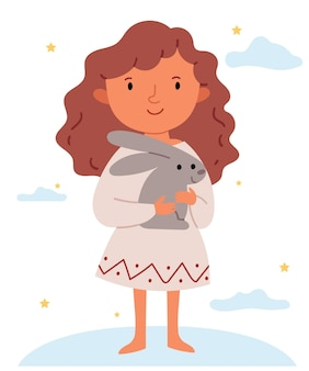 Het meisje in een witte jurk knuffelt een konijn