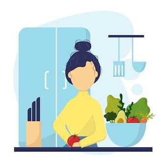 Het meisje kookt in de keuken het meisje bereidt een groentesalade in de keuken