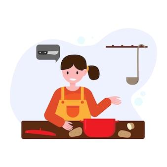 Het meisje kookt, snijdt aardappelen. de vrouw verloor het mes.
