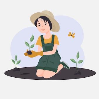 Het meisje plant planten. vrijwilligers om in de tuin of het park te werken. het concept van het opvoeden van kinderen om de natuur te beschermen.