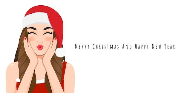 Het meisje van kerstmis blaast een kus in rode kleding en de hoed van de kerstmissanta