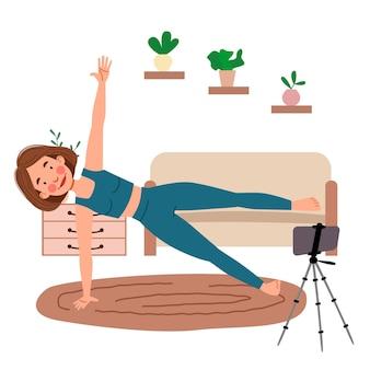 Het meisje volgt online lessen aan de telefoon, doet yoga. het concept van blijf thuis. live uitzending, online onderwijs. een vrouwelijk stripfiguur die hatha yoga beoefent. een vrouw sport binnenshuis.