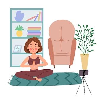 Het meisje volgt online lessen aan de telefoon, doet yoga. het concept van blijf thuis.