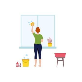 Het meisje wast het raam. een vrouw maakt het raam schoon. ingemaakte bloemen voor binnen. het concept van huiswerk